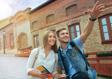 Happy couple of tourists taking selfie in old city. Stock Images
