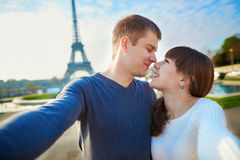 Happy couple of tourists taking selfie in Paris Royalty Free Stock Photography