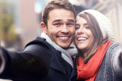 Happy couple of tourists taking selfie stock photography
