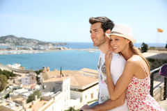 Happy couple of tourists travelling in ibiza island. Happy couple of tourists visiting Ibiza island in summer Royalty Free Stock Photos