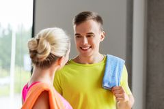 Happy couple with towels in gym royalty free stock photo