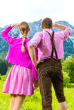 Happy couple in Alpine meadow Royalty Free Stock Image