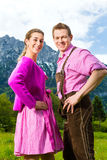 Happy couple in Alpine meadow stock photo