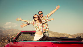 Happy couple travel by car in the mountains Stock Image