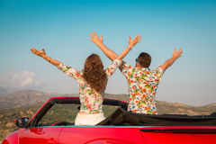 Happy couple travel by car in the mountains Royalty Free Stock Photos
