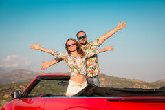 Happy couple travel by car in the mountains Royalty Free Stock Image