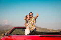 Happy couple travel by car in the mountains Royalty Free Stock Photography