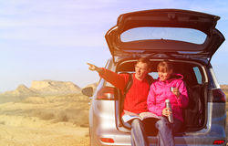Happy couple travel by car in scenic mountains Royalty Free Stock Images