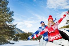 Happy couple travel by car in winter Stock Photos
