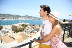 Happy couple on a travel in ibiza stock photography