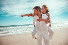 Happy couple. Travel summer lofestyle couple on the beach royalty free stock photography