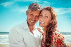 Happy couple. Travel summer lofestyle couple on the beach royalty free stock image