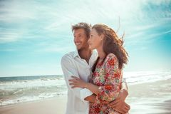 Happy couple. Travel summer lofestyle couple on the beach royalty free stock photos