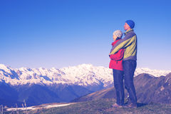 Happy couple of travelers hugging and enjoying the view stock images