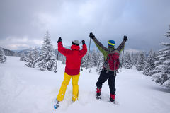 Happy couple of travelers on snowshoes Stock Image