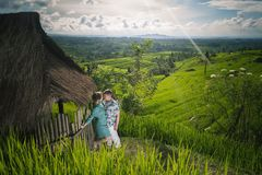 Happy couple traveling at Bali, rice terraces of Jatiluwih, Ubud Royalty Free Stock Photo