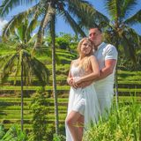 Happy couple traveling at Bali, rice terraces of Tegalalang, Ubud. Honeymoon summer travel at Indonesia. Happy people Stock Images