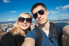 Happy couple traveling at the city and making selfie. Around the city stock images