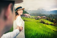 Happy couple traveling in jatiluwih rice terrace, Bali, Indonesia. Stock Photography