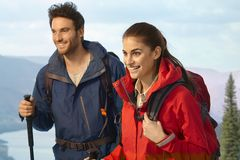 Happy couple trekking together Royalty Free Stock Images