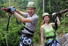 Happy couple after a trip on the cable traks Stock Photography