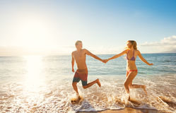 Happy Couple on Tropical Beach at Sunset Royalty Free Stock Photography