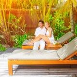 Happy couple on tropical resort Stock Photos