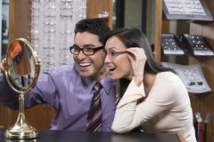Happy Couple Trying On Glasses Stock Photo
