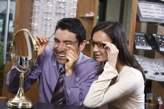 Happy Couple Trying On Glasses Stock Photography