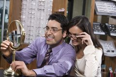 Happy Couple Trying On Glasses Royalty Free Stock Images