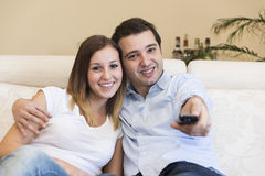Happy couple tv home Stock Images