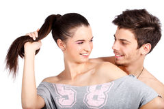 Happy couple of two attractive man and woman. Happy young couple flirting and playing, smiling. Isolated on white background. High resolution studio image Royalty Free Stock Photo