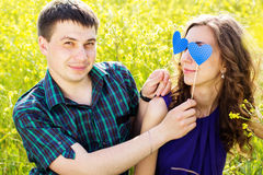 Happy couple with two blue hearts Royalty Free Stock Images