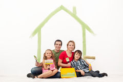 Happy couple with two kids repainting their home Royalty Free Stock Photography