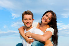 Happy couple under a blue sky Stock Photos