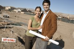 Happy Couple At An Under Construction Plot Stock Photography