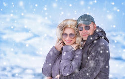 Happy couple under snowfall Stock Photography