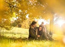 Happy couple under the tree royalty free stock photos