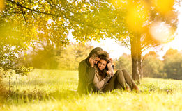 Happy couple under the tree  Stock Image