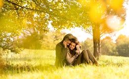 Happy couple under the tree stock image