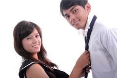 Happy couple with uniform. Young happy couple in love Stock Photography