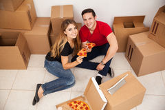 Happy couple unpacking Stock Photography
