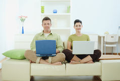 Happy couple using computer Royalty Free Stock Image