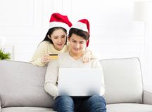 Couple Using Credit Card to Internet Shopping Stock Photography