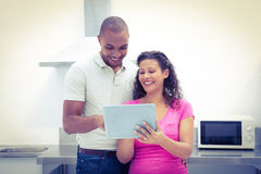 Happy couple using digital laptop Royalty Free Stock Images