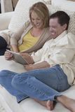 Happy Couple Using Digital Tablet Royalty Free Stock Photos
