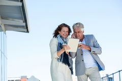 Happy couple using digital tablet Royalty Free Stock Image