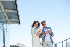 Happy couple using digital tablet and mobile phone Stock Image