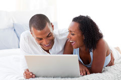 Happy couple using a laptop Stock Image