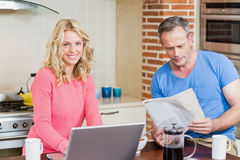 Happy couple using laptop and having breakfast royalty free stock image
